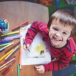 Adorable little boy, drawing picture for easter — Stock Photo #66473495