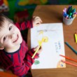 Adorable little boy, drawing picture for easter — Stock Photo #66473543