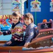 Two boys, riding boat in amusement park — Stock Photo #67862803