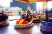 Father and his two sons,l having a ride in the bumper car at the — Stock Photo