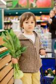 Cute little and proud boy helping with grocery shopping, healthy — Stock Photo