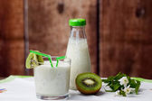 Healthy kiwi smoothie in a glass. Selective focus — Stock Photo