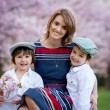 Beautiful kids and mom in spring park, flower and present. Mothe — Stock Photo #70902003