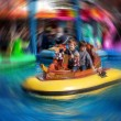 Two boys, riding boat in amusement park — Stock Photo #72899449