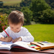 Adorable boy, drawing a painting in a book, outdoor — Stock Photo #72899611