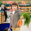 Cute little and proud boy helping with grocery shopping, healthy — Stock Photo #72899779