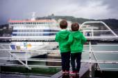 Two smiling little boys on deck of ferry — Stock Photo