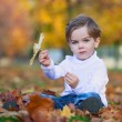 Cute little boy with basket of fruits in the park — Stock Photo #80111364
