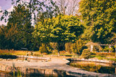 Old Garden with Stone Pools and Trees — Stock Photo