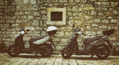 Two Mopeds in front of the Wall — Stock Photo