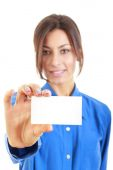 Smiling business woman in blue shirt showing blank business card — Stock Photo