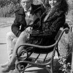 Young fashion elegant stylish retro couple sitting on bench — Stock Photo #56506373