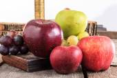 Apples and grapes on wooden background in domestic composition — Foto Stock