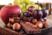 Bunch of fruit apples and grapes with nuts chocolate — Stock Photo