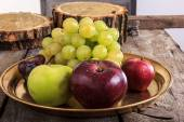 close up of fresh organic fruits on yellow copper metal tray ,  — Photo