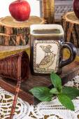 Close up of interesting cup of tea with message on a wooden tabl — Stock Photo