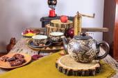 Cups of tea on old wooden table, with apples and nuts — Stock Photo