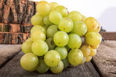 Fresh green grapes on wooden background — Foto de Stock