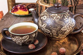 Still life with hot tea in autumn decoration — Stockfoto