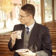Man with mustache and glasses on train wooden wagon drinking cof — Stock Photo #57730745