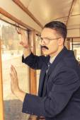 Shocked man with a mustache in a suit with glasses posing in an  — Fotografia Stock