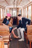 Young man in suit in the wagon train  with smiling woman look at — Stock Photo