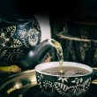 Pour tea from teapot in retro concept — Stock Photo #58170973