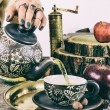 Pouring tea from teapot on old retro wooden table — Stock Photo #58171003