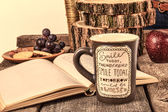Printed mug on wooden table with open book for relaxing — Stock Photo