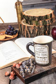 Retro table with book and cup of tea or coffee — Fotografia Stock