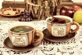 Tea cups with wooden strainer on dairy — Fotografia Stock