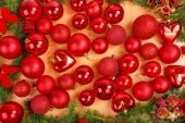 Christmas decoration with many scattered red round ornaments  — Stock Photo