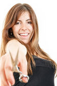 Beautiful girl holding scissors smiling — Stock Photo