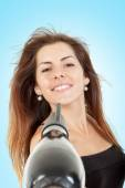 Girl dries long hair with hairdryer — Stock Photo