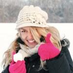 Постер, плакат: Happy woman in snow holding snow ball in hand for snowballing