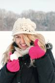 happy woman in snow holding snow ball in hand for snowballing — Stock Photo