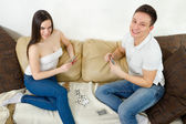 Young couple  relaxing and playing cards on blanket and pillows — Stock Photo