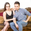 Attractive couple, pair of lovers at ancient living room sitting — Stock Photo #77955434