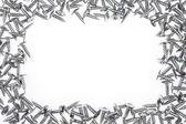 Silver screws on white background — Stock Photo