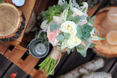 Bridal bouquet of roses on a wooden planks — Stock Photo