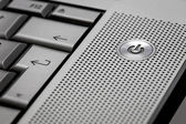 Closeup of silver computer laptop selective focus on standby on  — Stock Photo