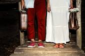 Young married couple standing together with suitcases — Stock Photo