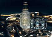 Perfume bottle on golden background — Stock Photo