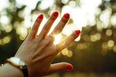 Hand and sun rays — Stock Photo