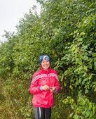 Girl holding berries - blackthorn. — Stock Photo