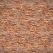 Old dark brown and red brick wall for texture and background — Stock Photo #58749697