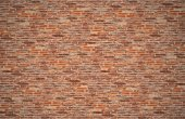 Old dark brown and red brick wall for texture and background — Stock Photo