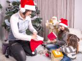 Family with gifts near a Christmas tree. — Stock Photo
