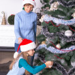 Mom and daughter decorating the Christmas tree — Stock Photo #58976597
