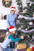 Mom and daughter decorating the Christmas tree — Stock Photo